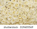 Stock photo isolated close up of a huge bouquet of white roses 319605569