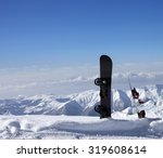Two Snowboards In Snow Near Of...