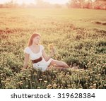 young woman  on a field   Shutterstock . vector #319628384