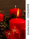 Small photo of an advent wreath for christmas promises a romantic mood in the silent advent.