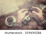 photographer with retro camera. ... | Shutterstock . vector #319654286