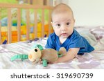 baby boy playing with soft toy... | Shutterstock . vector #319690739
