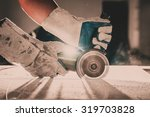 gloved hand of a construction... | Shutterstock . vector #319703828