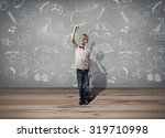 boy holding pen and writing... | Shutterstock . vector #319710998