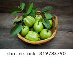 fresh green guavas on old wood... | Shutterstock . vector #319783790