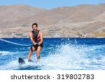 Happy Man Waterskiing And...