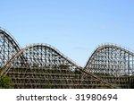 Wooden Roller Coaster Against...