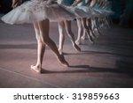 Dancers in white tutu...