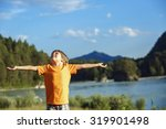 the boy raised his hands up... | Shutterstock . vector #319901498