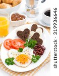 fried eggs in the form of heart ... | Shutterstock . vector #319936646
