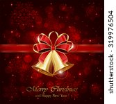 christmas bells and red bow on... | Shutterstock .eps vector #319976504