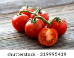 Fresh Tomatoes On Wood...