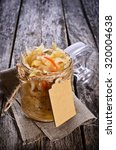 Small photo of Salad of sauerkraut and carrots in rustic style. Selective focus.