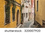 narrow street. rothenburg ... | Shutterstock . vector #320007920
