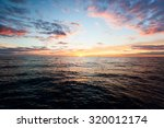 sunset over the ocean | Shutterstock . vector #320012174