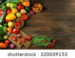 Small photo of Heap of fruits and vegetables on wooden background