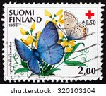 Small photo of FINLAND - CIRCA 1990: a stamp printed in the Finland shows Amanda's Blue on Meadow Vetchling, Agrodiaetus Amandus, Butterfly, circa 1990