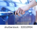 car key in woman's hand | Shutterstock . vector #32010904