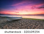 Boat And Violet Sunrise