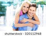 happy young couple outdoors | Shutterstock . vector #320112968