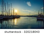 sunset behind the yachts at...