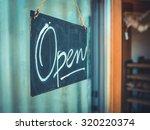 rustic open sign hanging in the ... | Shutterstock . vector #320220374