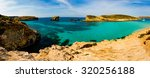 the blue lagoon on comino... | Shutterstock . vector #320256188