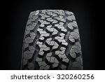 off road tire isolated on black ... | Shutterstock . vector #320260256