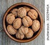 walnuts in a bowl   rustic... | Shutterstock . vector #320294414