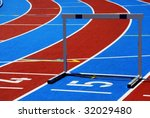 Athletic track with numbers and hurdle - stock photo