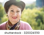 Small photo of Headshot portrait of an amiable elderly woman smiling