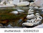stone in balance near a river | Shutterstock . vector #320342513