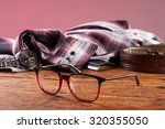 clock  glasses and a shirt on a ... | Shutterstock . vector #320355050