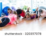 women exercising on floor with