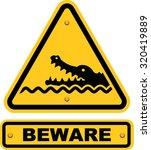 beware of crocodiles sign | Shutterstock .eps vector #320419889