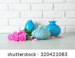 beautiful roses and vases on... | Shutterstock . vector #320421083