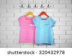 child clothes on hanger on... | Shutterstock . vector #320432978