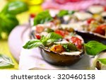 baked eggplants stuffed with... | Shutterstock . vector #320460158