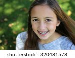 pretty girl with big brown eyes ... | Shutterstock . vector #320481578