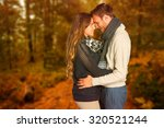 side view of young couple... | Shutterstock . vector #320521244