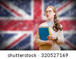 young woman in glasses holding... | Shutterstock . vector #320527169