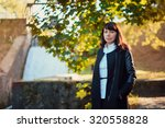 Stock photo beautiful girl years in business suit walking in the autumn forest 320558828