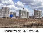 hoisting cranes and modern... | Shutterstock . vector #320594858