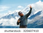 Hiker At The Top Of A Pass Wit...