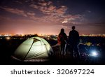 night camping near the town. a... | Shutterstock . vector #320697224