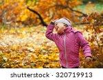 little girl in a pink jacket... | Shutterstock . vector #320719913