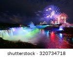 niagara falls lit at night by... | Shutterstock . vector #320734718