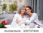 family day. aged woman and her... | Shutterstock . vector #320737604