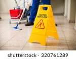 low section of worker mopping... | Shutterstock . vector #320761289