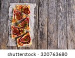 cake with figs  jam and nuts on ... | Shutterstock . vector #320763680